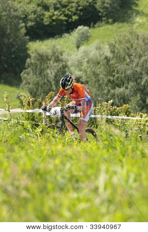 MOSCOW, RUSSIA - JUNE 9: Bronze medalist Anne Terpstra (Netherlands) races during the European Mountain Bike Cross-Country Championship in Moscow, Russia at June 9, 2012