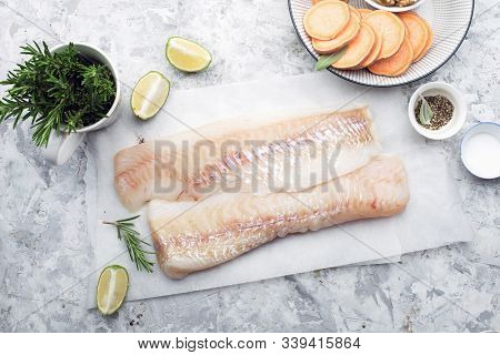 Fillet Of White Sea Organic Cod Before Cooking With Minimal Healthy Food Ingredients. Pure Protein.