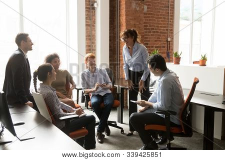 Cheerful Diverse Office Workers And Coach Team Leader At Corporate Training