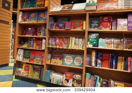 Children Drawing And Coloring Books On Shelves In A Bookstore For Sale. Library Kids Books Section.