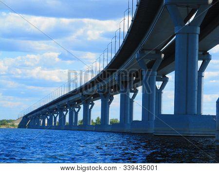 Bridge Piers. Bridge Interchange On Sky Background. Modern Road Junction Over The River. Concept - B