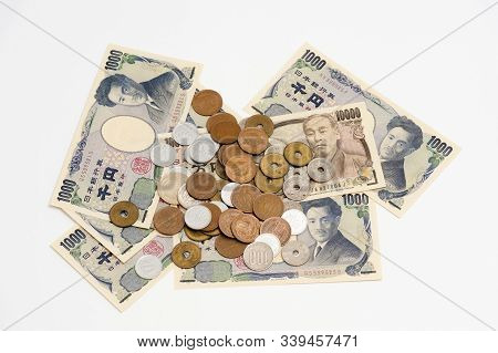 Yen - Japanese Money In One Thousand Yen, Ten Thousand Yen Banknotes And Various Coins Isolated On W