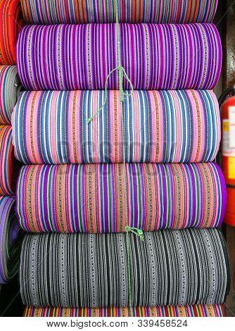 Peruvian traditional colourful native handicraft textile fabric at market in Cusco, Cusco Region Peru, South America. Selective focus, Close up.