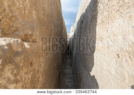 Jerusalem, Israel, December 07, 2019 : Narrow Passage Between Boulders On Archaeological Excavations