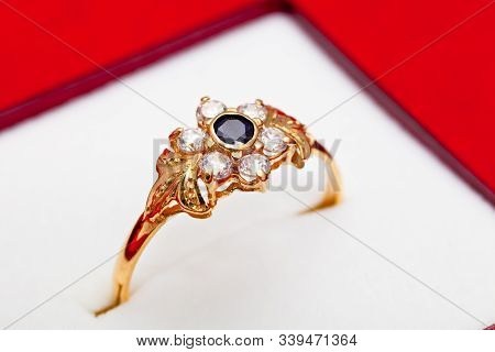 Fantastic Gold Ring Adorned With One Blue  And Several White Zirconia