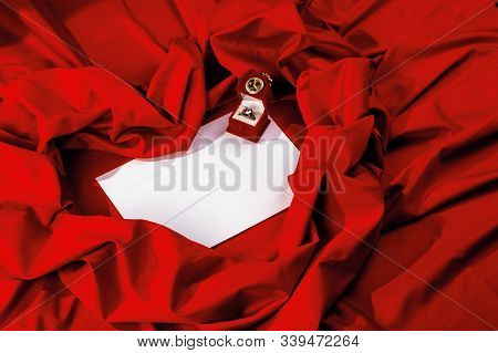 Valentine Card Composition On A Red Fabric. There Is Always Some Madness In Love Let Me Be Yours Mes