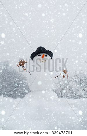 Snowman And Snow Day. Snowman With A Bag Of Gifts. Funny Snowman With A Carrot Instead Of A Nose And