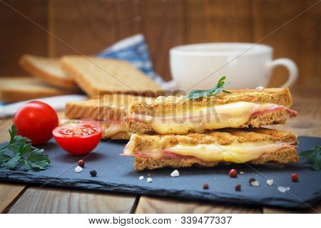 Club Sandwiches For Quick Breakfast. Grilled Or Toasted Sandwiches With Ham Salami, Tomato And Melte