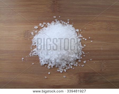 A Large Crystalline Salt Spreads On The Wooden Surface