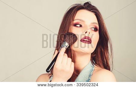 Skin Tone Concealer. Cosmetics Shop. Emphasize Femininity. Girl Apply Eye Shadows. Woman Applying Ma