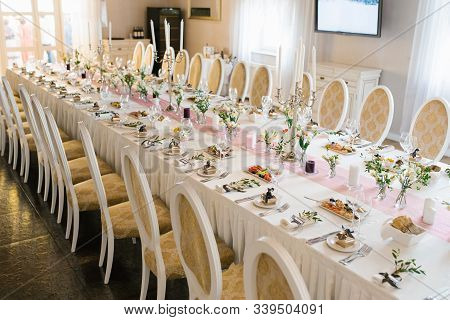 Beautiful Classic Festive Banquet Table At Wedding In Restaurant