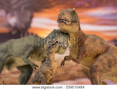 Family Of Tyrannosaurus Rex With Baby Tyrannosaurus Rex With Jurassic Land In The Background. Family
