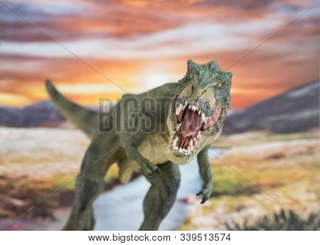 Tyrannosaurus Rex In The Foreground With Cretaceous Land In The Background At Sunrise