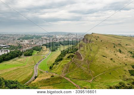Landscape Of Edinburgh City In Scotland Viewed From Arthurs Seat In Overcast Weather