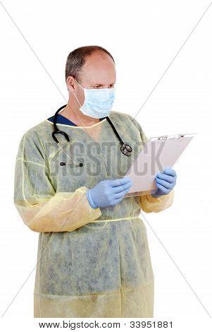 Surgeon reading clipboard
