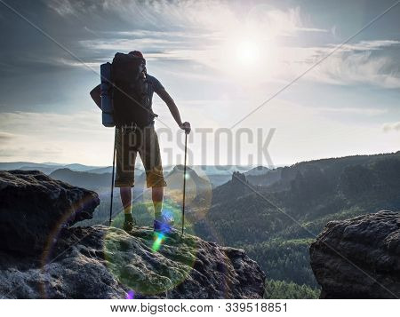 Hiker Hold Trekking Sticks For Nordic Walking And Deep Breath At The Edge.