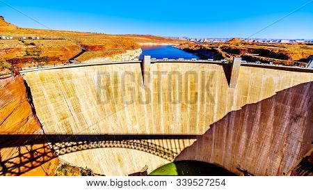 The Glen Canyon Dam With Lake Powell Behind The Dam, Created By The Colorado River. Viewed From The