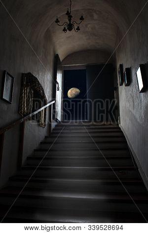 Exit Dungeon Upstairs Overlooking Starry Sky And Moon. Magical View Of Moon From Dark Room. Doorway