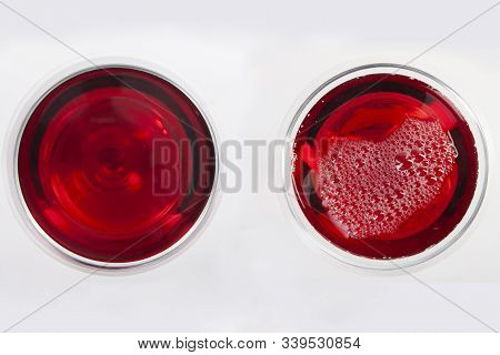 Glass Of Red Wine With Shadow.top View. Abstract Red Wine Bubbles.