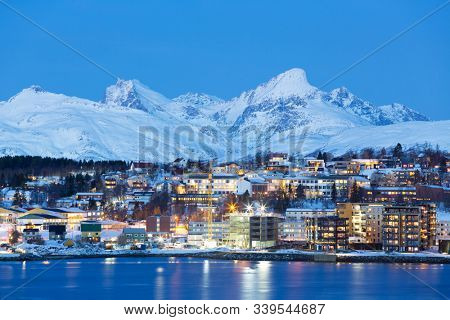 Tromso At Full Moon In Winter Time, Christmas in Tromso, Norway.