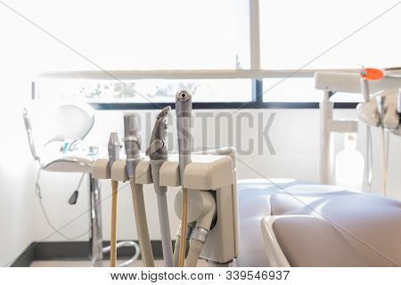 Sunlight Room Shines On Orgainzed Dental Hygienist Suction, Water, And Air Syringe Tools Ready For A