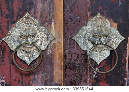 A Pair Of Traditional Door Knockers In Guangdong Province, China, With Inscriptions Of