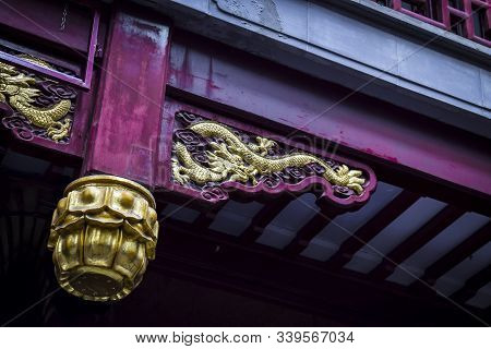 Architectural Detail Of Chinese Traditional Building That Is Red And Gold