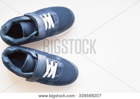 Pair Of Blue Running Shoes Isolated On A Pastel Background. Trendy Shoes.kids Blue Sneakers.colorful