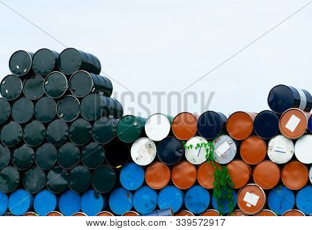 Old Chemical Barrels. Blue, Orange, And Black Oil Drum. Steel Oil Tank. Toxic Waste Warehouse. Hazar