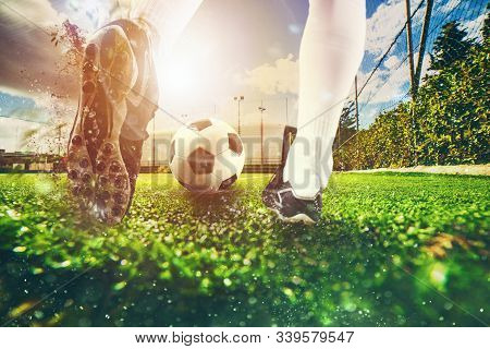 Close Up Scene At Soccer Field With A Soccer Shoe Hitting The Ball During Training