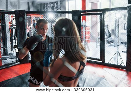 Fully Concentrated. Athletic Young People Have Sparring On The Boxing Ring.