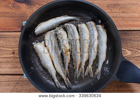 Step-by-step Cooking Of Fried Smelt In A Pan, Step 5 - Frying Smelt Fish In Oil, Top View, Selective
