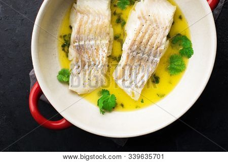 Steamed Cod Fillet Butter-lemon Sauce With Herbs In The Oven. Top View. In A Baking Dish. Healthy Ea