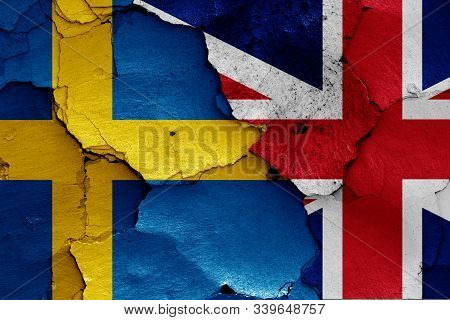 Flags Of Sweden And Uk Painted On Cracked Wall