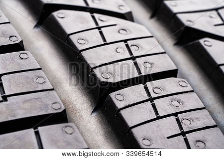 Road Tread Protector All-season Summer Tire. Close Up. The Tread Blocks And Sipes For Evacuating Wat