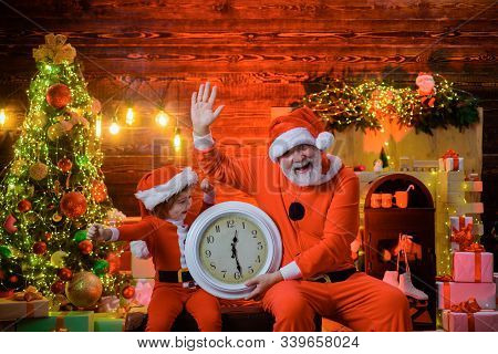 Merry Christmas. Happy New Year. Christmas Boy With Clock. New Year Midnight. Time For Christmas. Li
