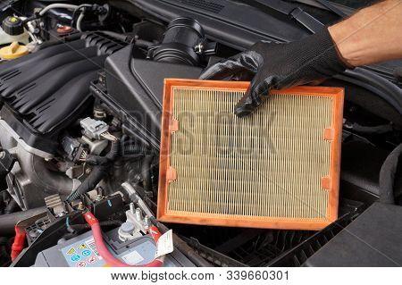 Replacing The Car Air Filter. Car Repair Shop.