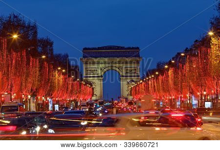 The Triumphal Arch And Champs Elysees Avenue Illuminated For Christmas 2019 , Paris, France.
