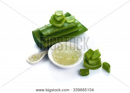 Slices Of Aloe Vera Leave And Aloe Vera Gel In A Bowl On A White Background. Aloe Vera Is A Very Use