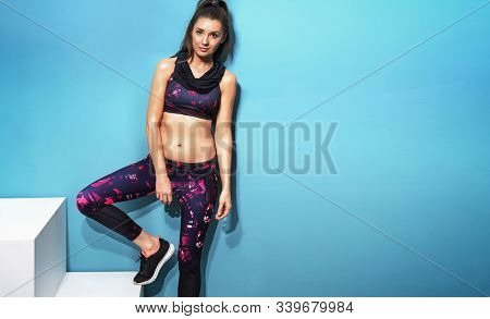 Beautiful healthy fitness woman exercising