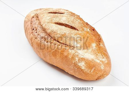 Whole Loaf Of A Crispy Bread On White Background. Delicious Rye Bread. Homemade Bread Recipe.