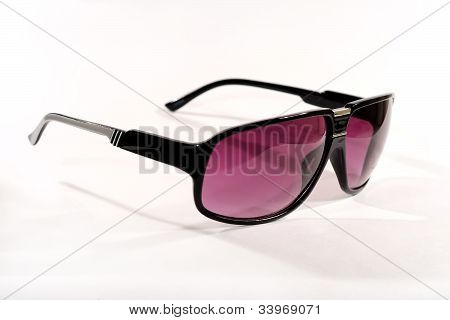 Pair of fashionable modern sunglasses with graduated polarised lenses on a white background poster