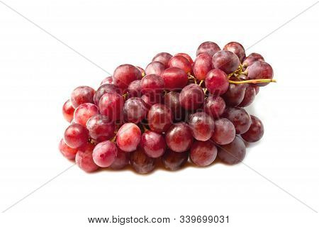 Ripe Red Grape. Pink Bunch  Isolated On White Background
