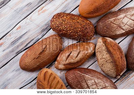 Organic Healthy Bread On Wooden Background. Artisan Bread Loaves. Homemade Bread Recipe.