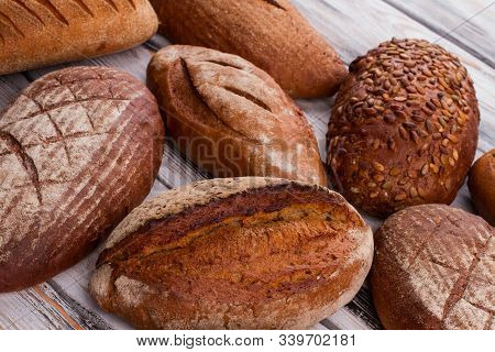 Fresh Bread Loaves Background. Artisan Bread Loaves. Homemade Bread Recipe.