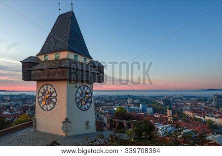 Cityscape Of Graz And The Famous Clock Tower (grazer Uhrturm) On Shlossberg Hill, Graz, Styria Regio