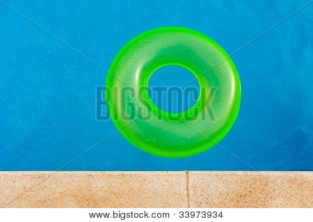 Bright yellow floater in the middle of the pool