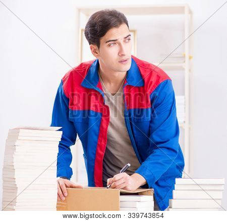 Worker in publishing house preparing book order