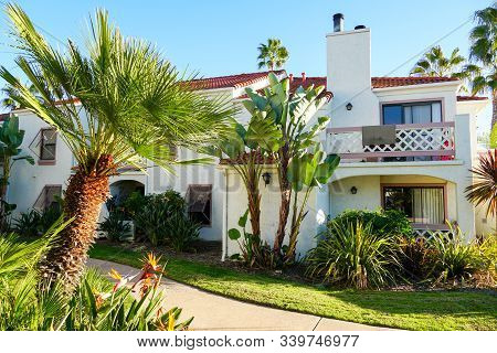 Typical Southern California Spanish Style Residential Condo Surrounded By Nice Garden With Trees. Sa