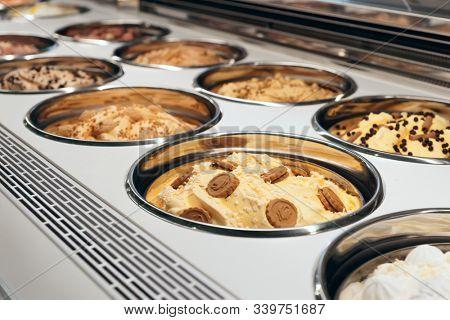 Ice-cream on refregerated counter in Italian gelateria